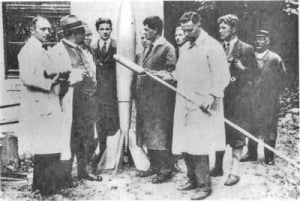Rudolf Nebel, left, is pictured with German rocketeers including (second from right) Wernher von Braun, 19 at the time, and Professor Hermann Oberth (to the right of the rocket). - Image credit: NMMSH Archives