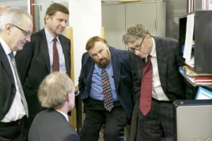 Bill Gates (far left) listens to Dr. Vittorio Violante at ENEA.
